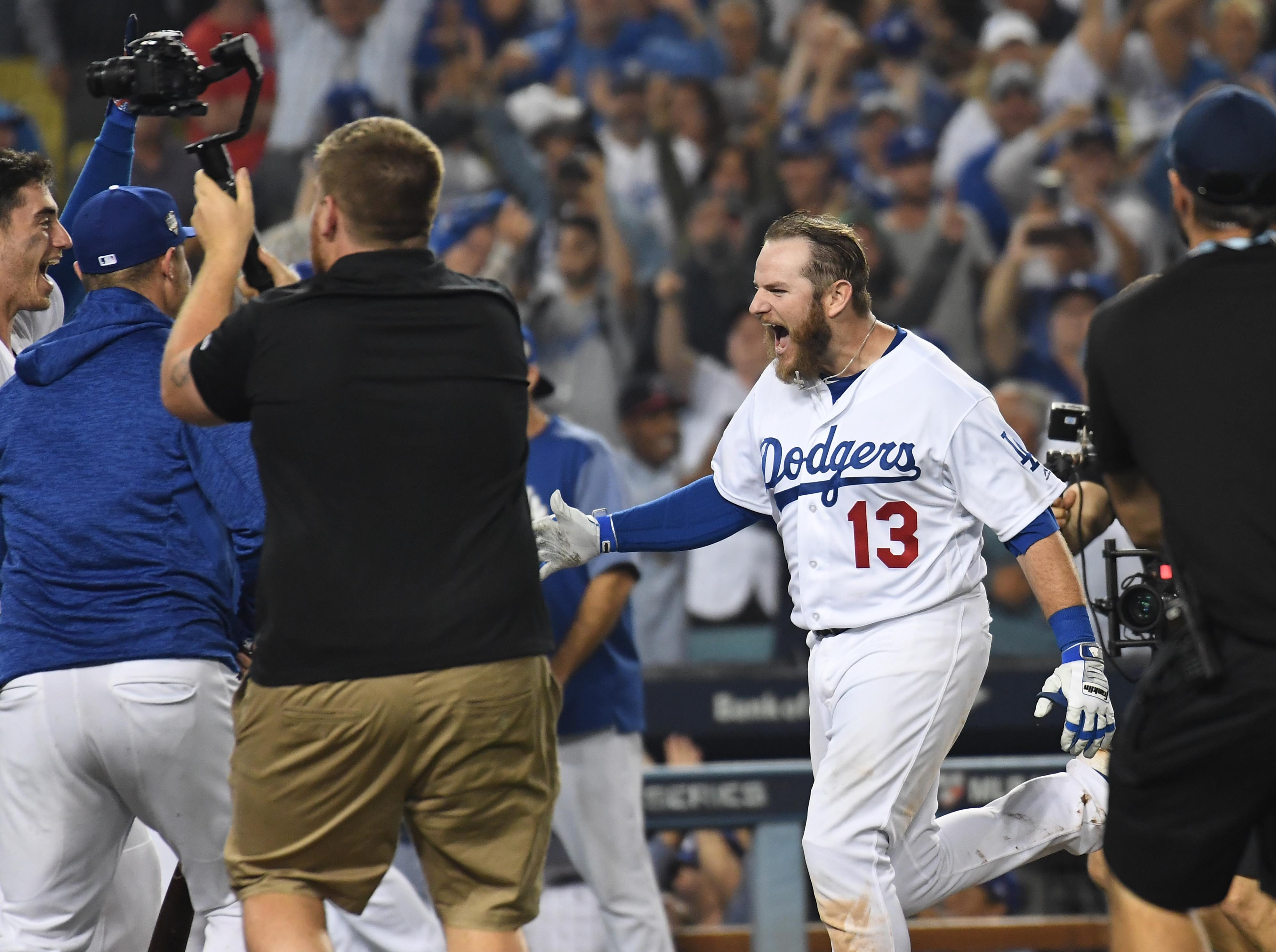 Game 3 at Dodger Stadium: Max Muncy celebrates his walk-off homer in the 18th.
