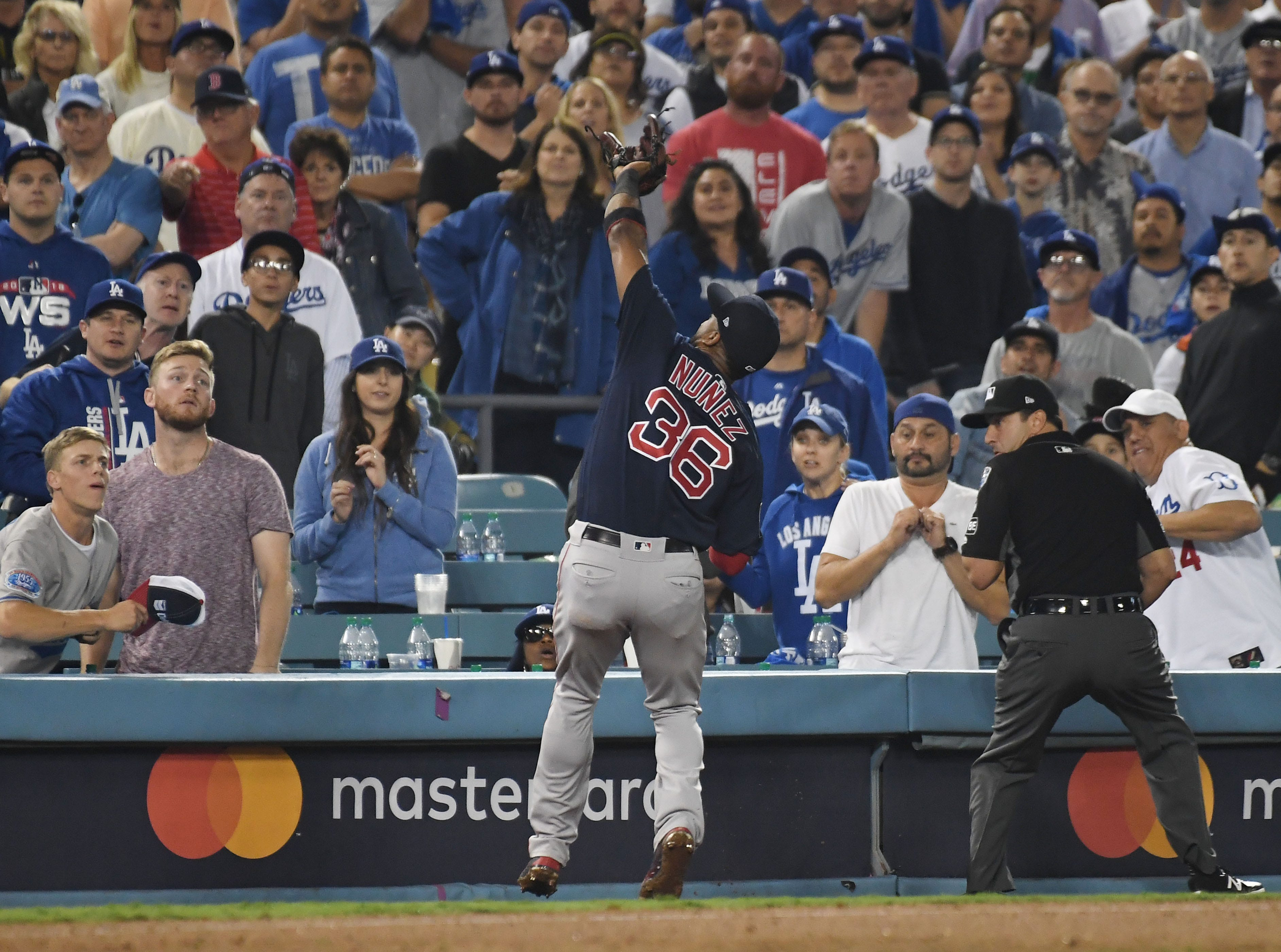 Game 3 at Dodger Stadium: Eduardo Nunez catches a foul ball in the 13th inning.