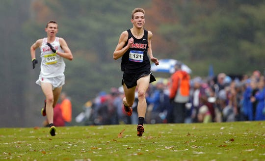 Rowen Ellenberg of Kimberly and Matthew Meinke of Neenah near the finish line in the WIAA Division 1 state cross country meet Saturday in Wisconsin Rapids.