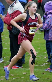 Allison Butte of Winneconne runs during the Division 2 girls race of the WIAA state cross country meet.