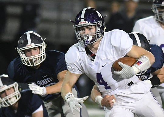 Rumson's Ian O'Connor looks for running room as Rumson Fair Haven Football takes on Middletown South on 10/26/2018
