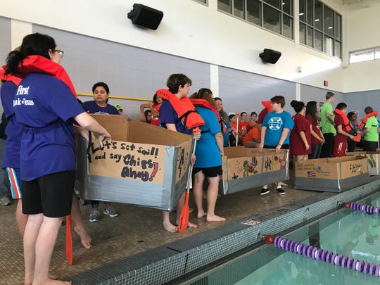 Teams of ATEMS High School students await the start of their cardboard boat race Saturday. The five teams competed for fastest first lap, most durable and most laps in the Abilene Christian University pool.