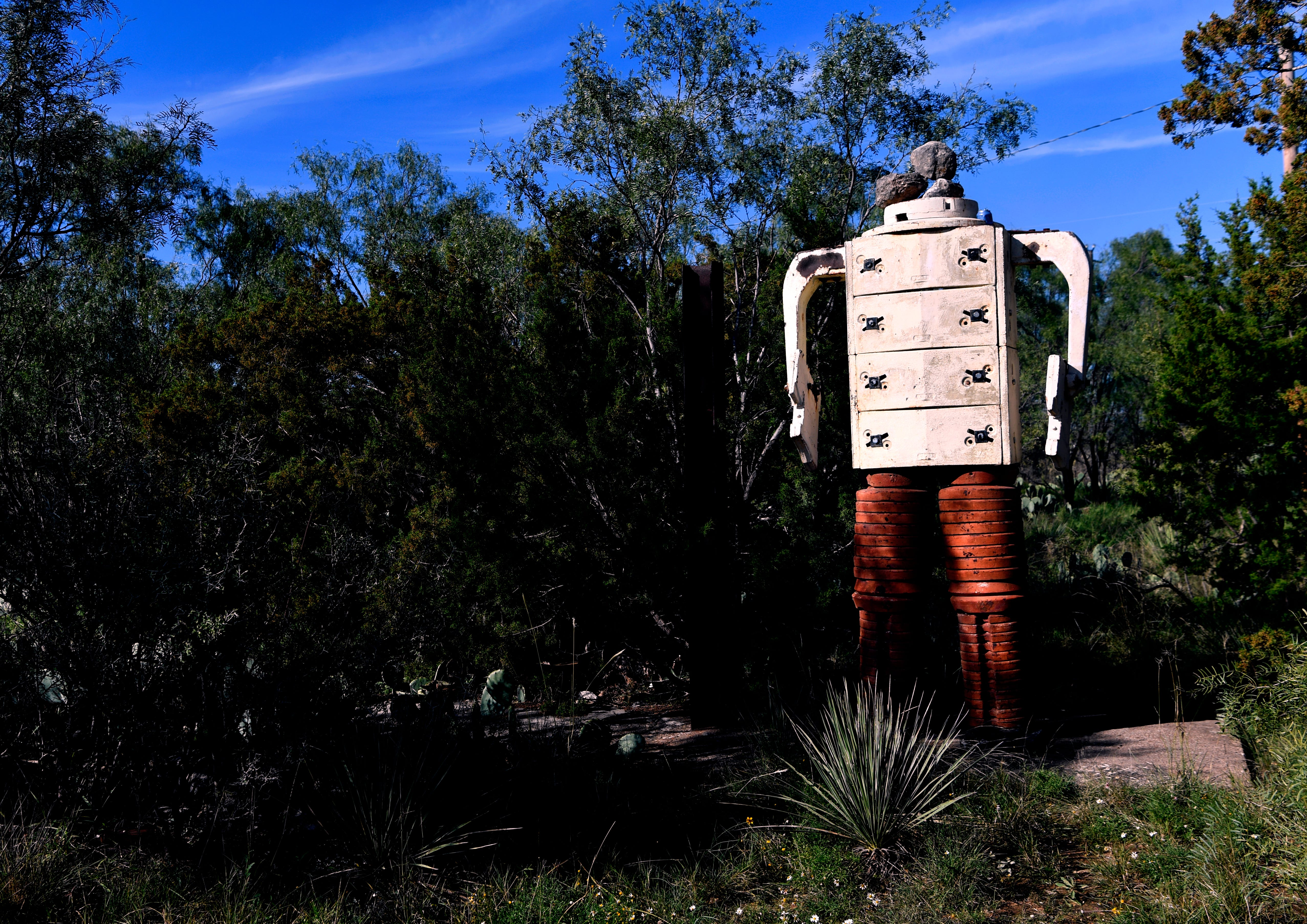 A robot made from oil field weights, but missing a head, stands near the edge of what remains of the Coke County community of Sanco. While people live in the area, a church is the only semi-official building left there.