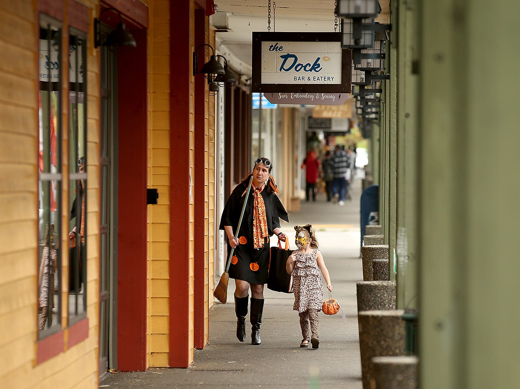 Diane Levitan and daughter Sasha Morris, 6, make their way through downtown Port Orchard on the search for candy during the Halloween Spookfest trick-or-treating in on Saturday, October 27, 2018.