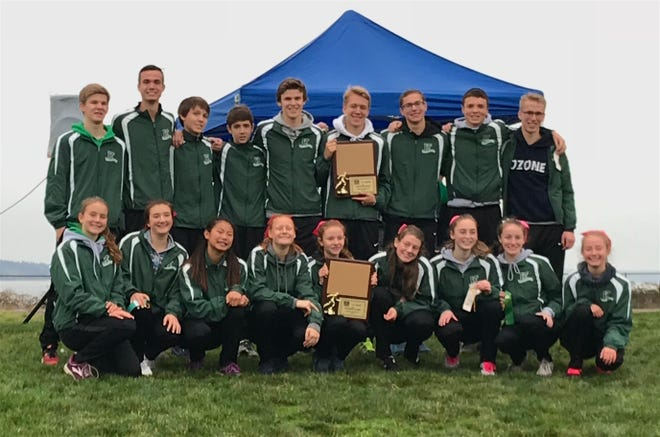 Klahowya's boys and girls cross country teams won district titles Saturday at the Westside Classic at Chambers Creek in University Place.