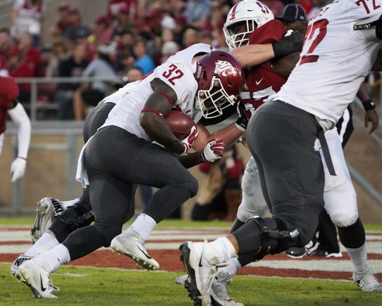 Washington State running back James Williams scores a touchdown in the second half.