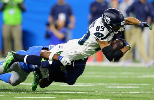 Seattle Doug Baldwin (89) is brought down after a reception by Lions cornerback Nevin Lawson.