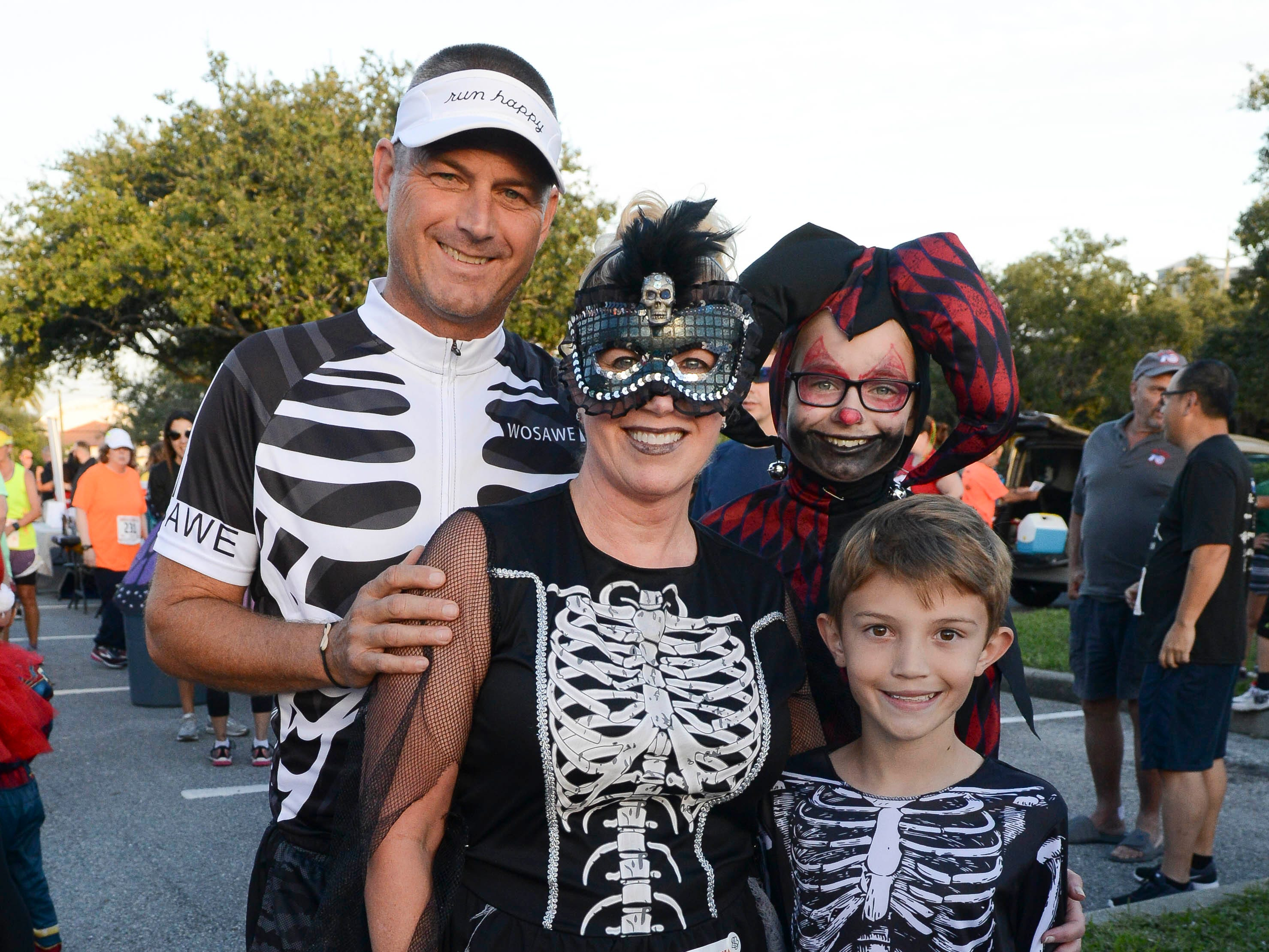 Matt, Tami, Tori and Clay Wrasmann, participants in the Ghostly Gecko 5K dressed in costume for the annual race right before Halloween.