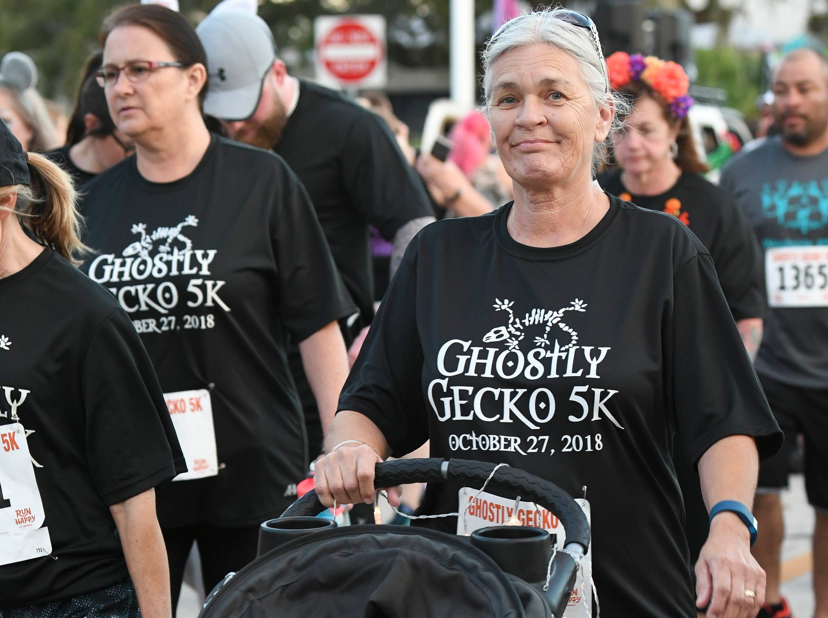 Participants in the Ghostly Gecko 5K dressed in costume for the annual race right before Halloween.