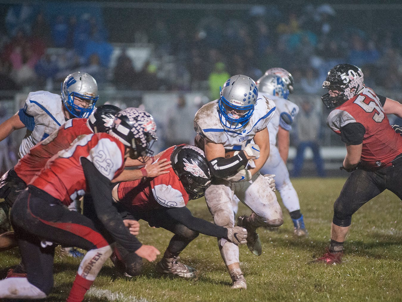 Bucyrus' Andrew Pifer attempts to wrap up Wynford's Kendall Blair.