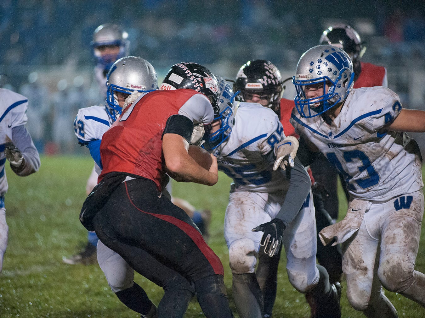 Bucyrus' Zane Seybert braces for a tackle from a trio of Wynford defenders.
