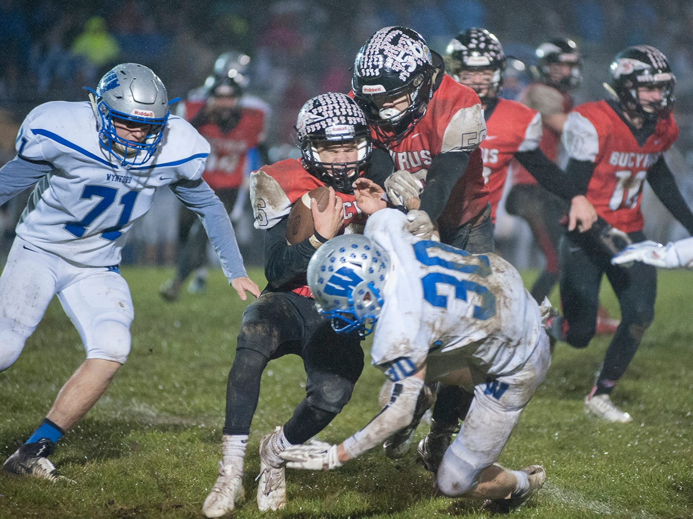 Wynford's Lucas Hackworth tackles Bucyrus' Lincoln Mollenkopf.