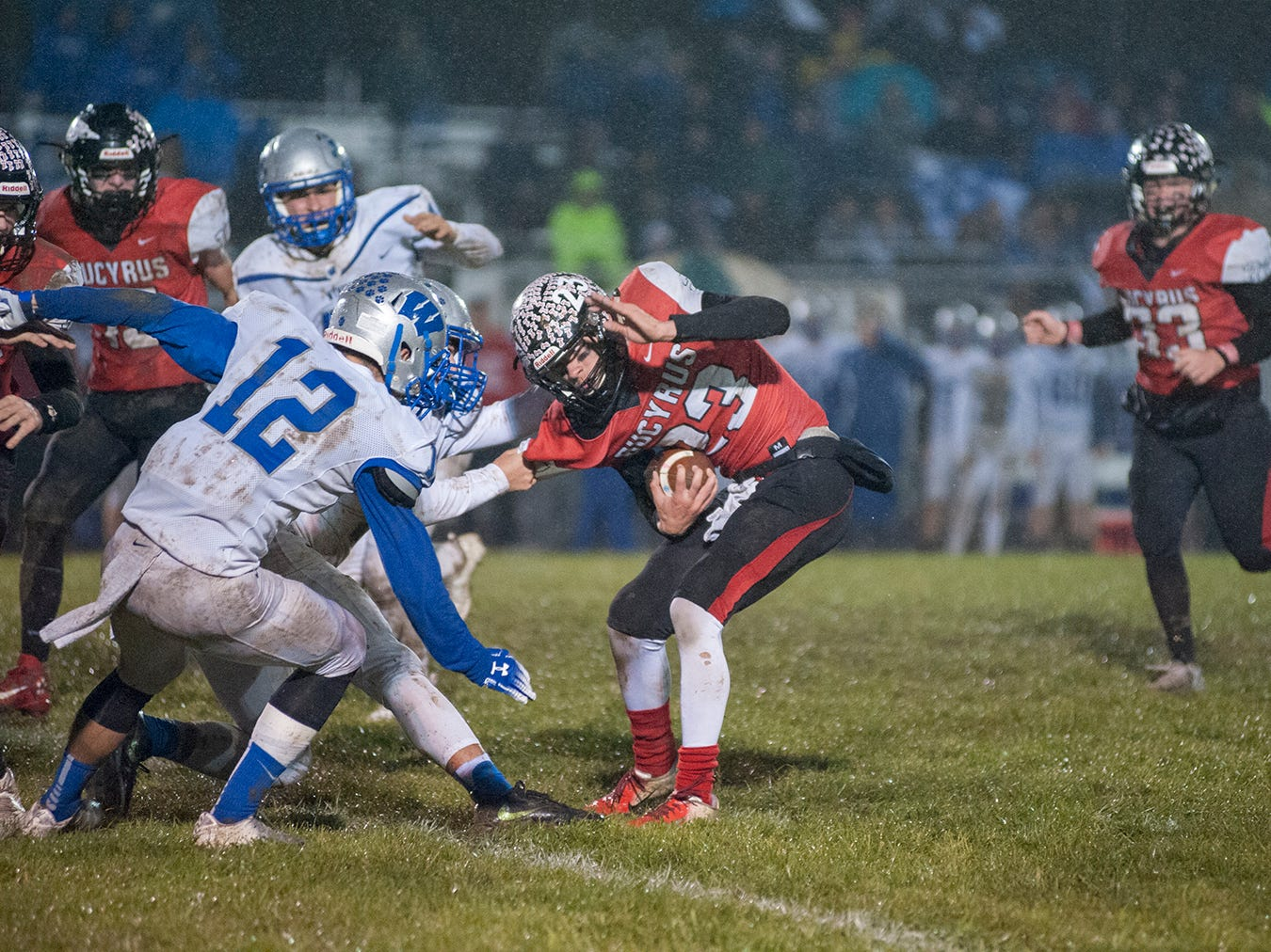 Bucyrus' Harley Robinson tries to avoid a tackle from Wynford's  Danny Bishop.