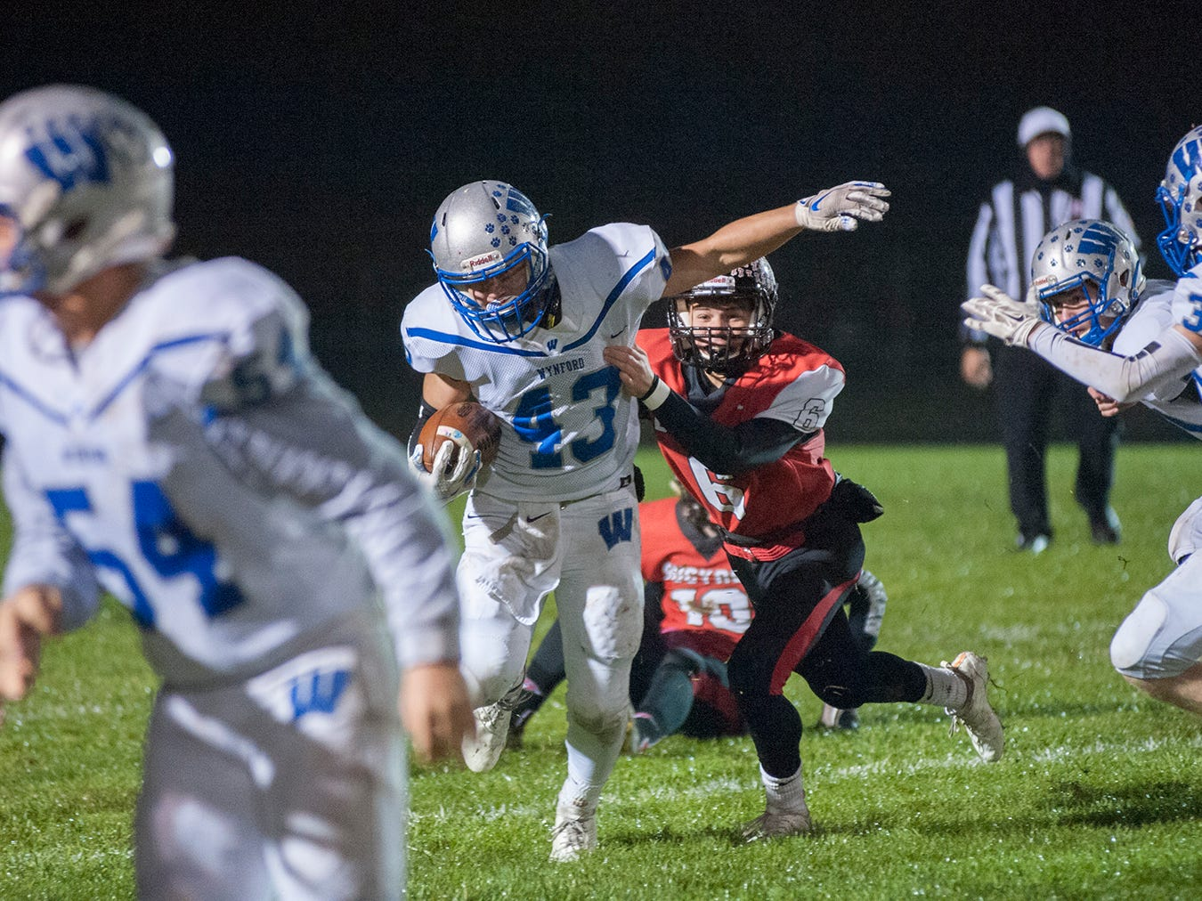 Wynford's Kendall Blair shakes a tackle from Bucyrus' Lincoln Mollenkopf.