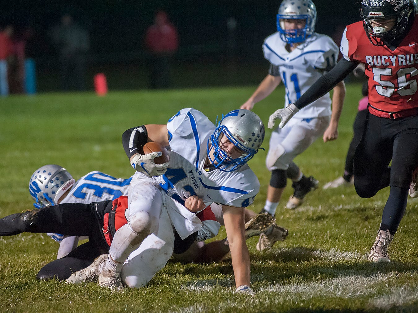 Wynford's Kendall Blair is brought down by a Bucyrus defender.