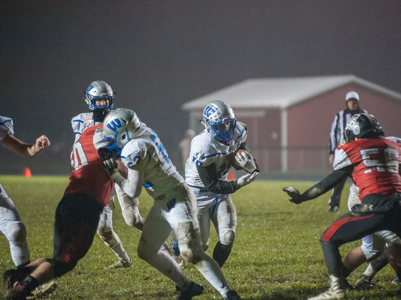 Wynford's Blake Sparks runs through a gap in the Bucyrus defense.