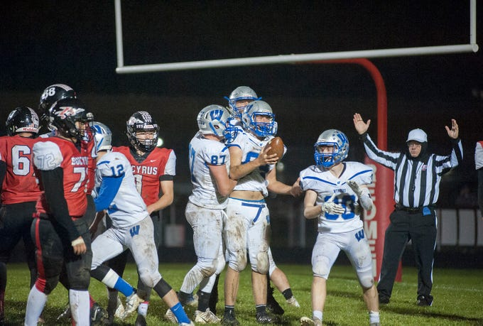 Wynford's Jacob Markley recovers a fumble in the end zone.