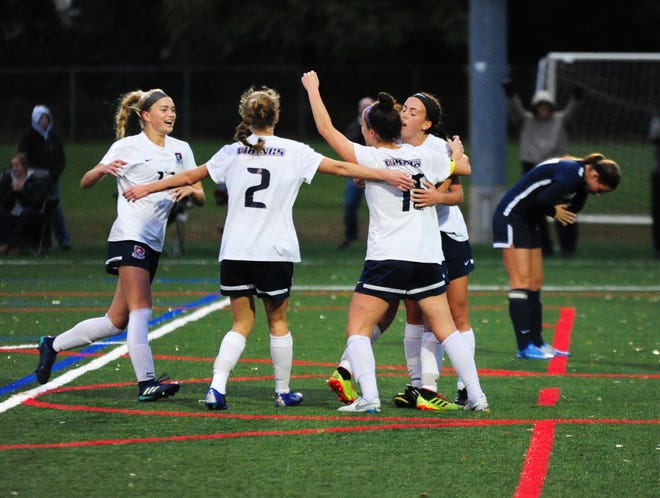 Eastern's Kelli McGroarty (second from right) and her teammates celebrate McGroarty's goal against Shawnee during Eastern's 2-1 win in the South Jersey Coaches Association soccer tournament championship game on Saturday, October 27, 2018.