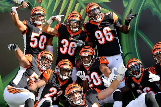 Cincinnati Bengals free safety Jessie Bates (30), center, and the Cincinnati Bengals defense pose for a photo after Bates's interception return for a touchdown in the third quarter during a NFL football game between the Tampa Bay Buccaneer and the Cincinnati Bengals, Sunday, Oct. 28, 2018, at Paul Brown Stadium in Cincinnati. Cincinnati Bengals won 37-34.