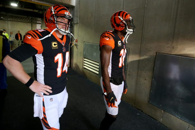 Cincinnati Bengals quarterback Andy Dalton (14), left, and Cincinnati Bengals wide receiver A.J. Green (18) wait to take the field before a NFL football game between the Tampa Bay Buccaneer and the Cincinnati Bengals, Sunday, Oct. 28, 2018, at Paul Brown Stadium in Cincinnati.