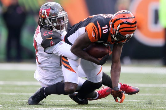 Cincinnati Bengals wide receiver A.J. Green (18) completes a catch in the fourth quarter during a NFL football game between the Tampa Bay Buccaneer and the Cincinnati Bengals, Sunday, Oct. 28, 2018, at Paul Brown Stadium in Cincinnati. Cincinnati Bengals won 37-34.