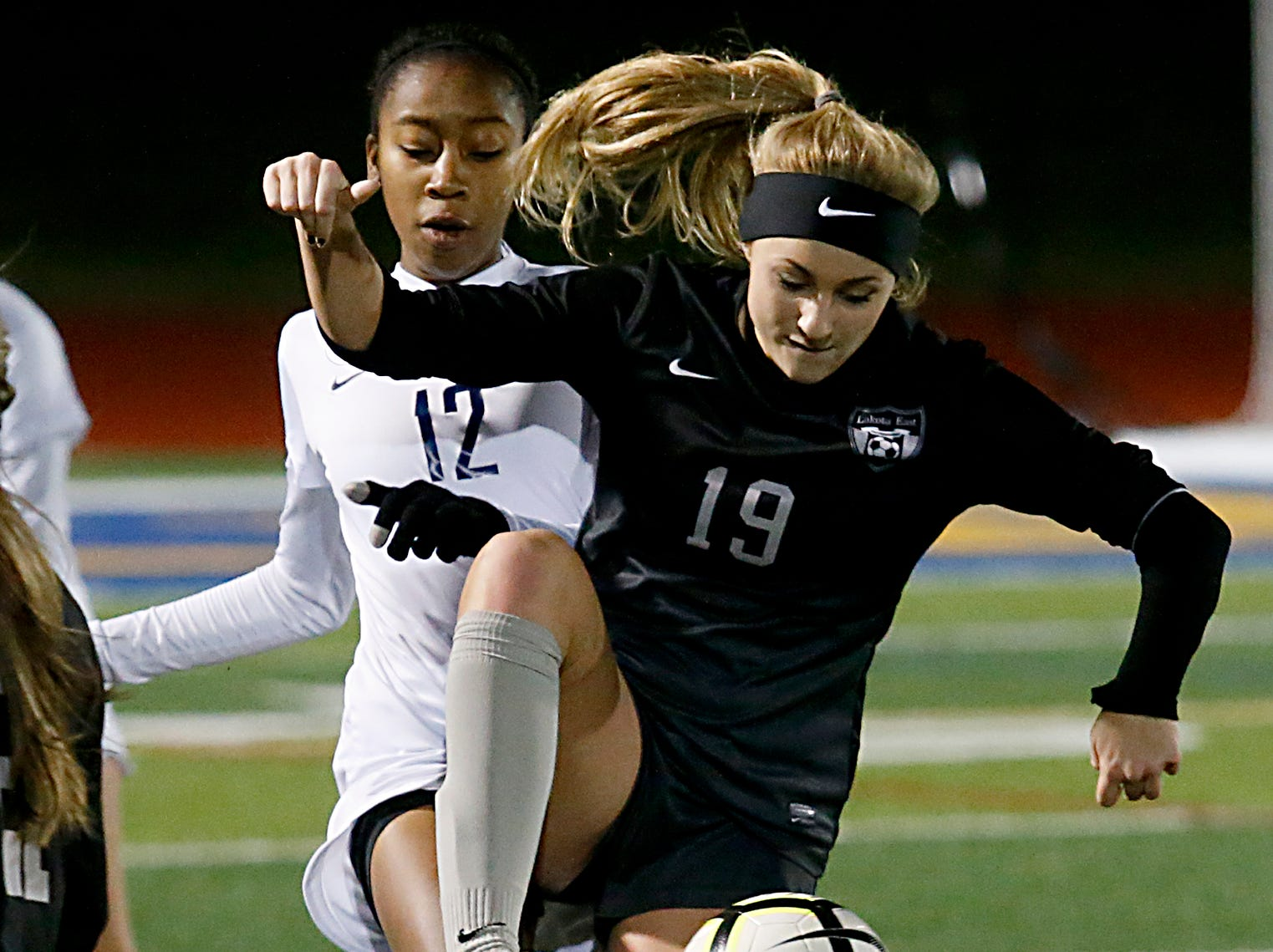 Mount Notre Dame forward Rey Riggins tries to steal from Lakota East defender Alexis Trammel during their Division I Southwest district final soccer game at Walnut Hills in Cincinnati Saturday, Oct. 27, 2018.