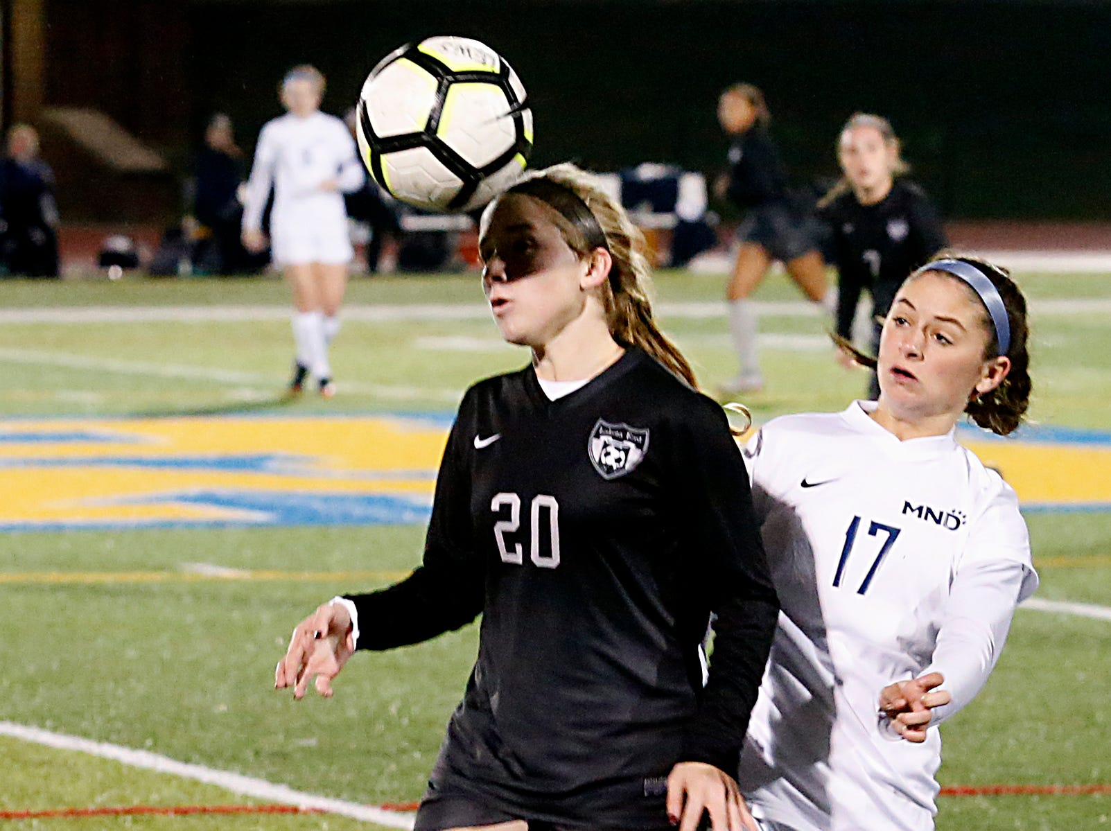Lakota East forward heads the ball away from Mount Notre Dame defender Eden Marques during their Division I Southwest district final soccer game at Walnut Hills in Cincinnati Saturday, Oct. 27, 2018.
