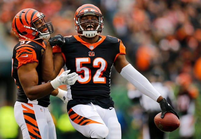 Cincinnati Bengals linebacker Vincent Rey (57) celebrates with linebacker Preston Brown (52) after Brown's interception in the first quarter of the NFL Week 8 game between the Cincinnati Bengals and the Tampa Bay Buccaneers at Paul Brown Stadium in downtown Cincinnati on Tuesday, Oct. 16, 2018.
