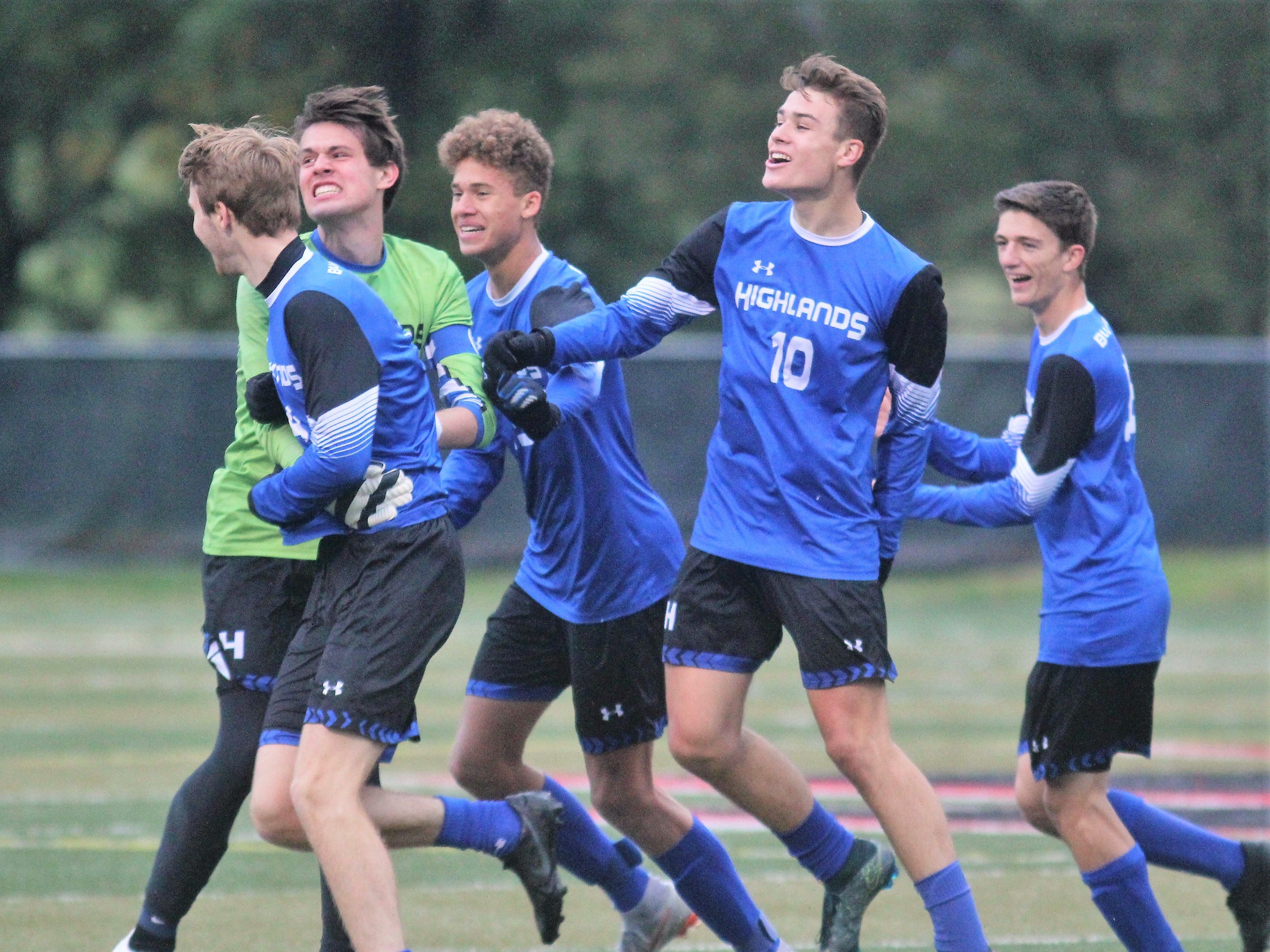 Highlands players celebrate their first goal of the game by Luke Schweitzer, far left, during Highlands' 3-0 win over Daviess County in a KHSAA boys soccer state quarterfinal Oct. 27, 2018 at Paul Laurence Dunbar HS, Lexington KY.