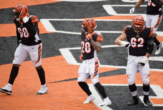 Bengals running back Joe Mixon (28) dances with guard Alex Redmond (62) and tackle Bobby Hart (68) after scoring a touchdown during the win against Tampa Bay.