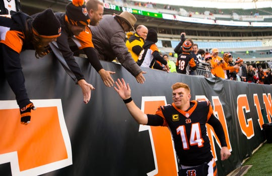 Cincinnati Bengals quarterback Andy Dalton (14) greets fans after a Week 8 NFL game between the Cincinnati Bengals and the Tampa Bay Buccaneers, Sunday, Oct. 28, 2018, at Paul Brown Stadium in Cincinnati. Cincinnati Bengals defeated Tampa Bay Buccaneers 37-34.
