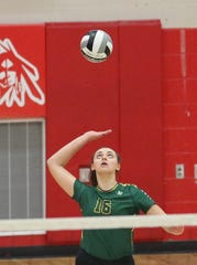 McNicholas' Caroline Pour (16) serves  during their district final against Alter, Saturday, Oct. 27,2018.
