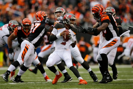 Tampa Bay Buccaneers quarterback Jameis Winston (3) is forced from the pocket by Cincinnati Bengals defensive end Carlos Dunlap (96) in the second quarter of the NFL Week 8 game between the Cincinnati Bengals and the Tampa Bay Buccaneers at Paul Brown Stadium in downtown Cincinnati on Tuesday, Oct. 16, 2018.