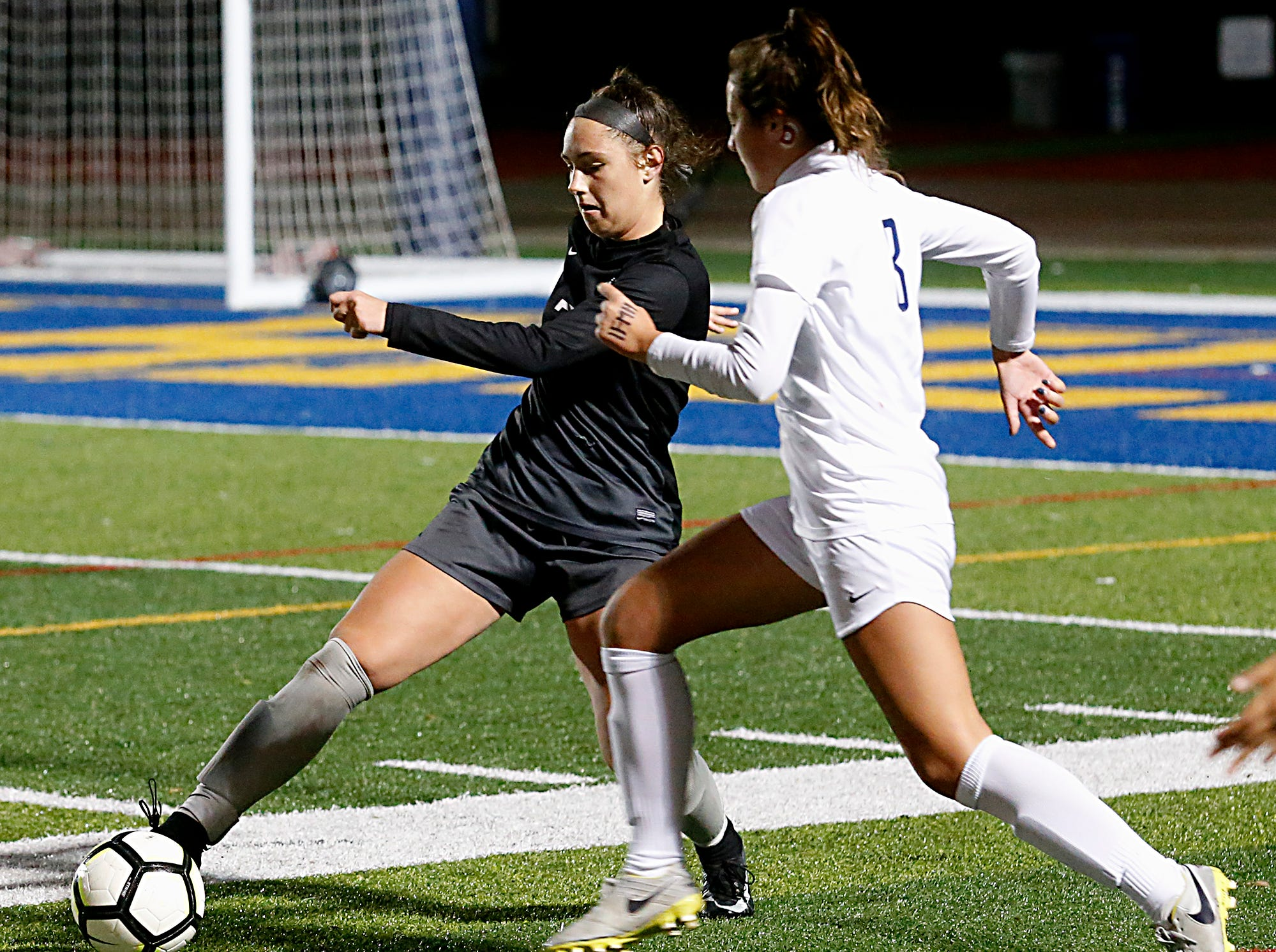 Lakota East forward Kate Larbes controls the ball as Mount Notre Dame forward Emily Wittekind tries to steal during their Division I Southwest district final soccer game at Walnut Hills in Cincinnati Saturday, Oct. 27, 2018.