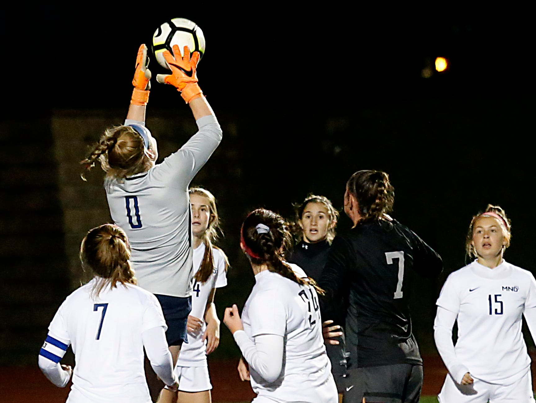 Mount Notre Dame keeper Becky Moss grabs a Lakota East corner kick during their Division I Southwest district final soccer game at Walnut Hills in Cincinnati Saturday, Oct. 27, 2018.