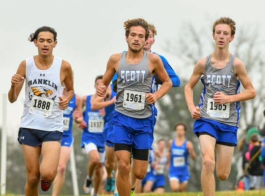Jaggur Hasler and Will Sandlin of Scott along with Marco Dempsey of Franklin County run in the Class 2A Boys KHSAA Regional Cross Country Championship, Sherman Elementary School, Grant County, KY, Saturday Oct. 27, 2018