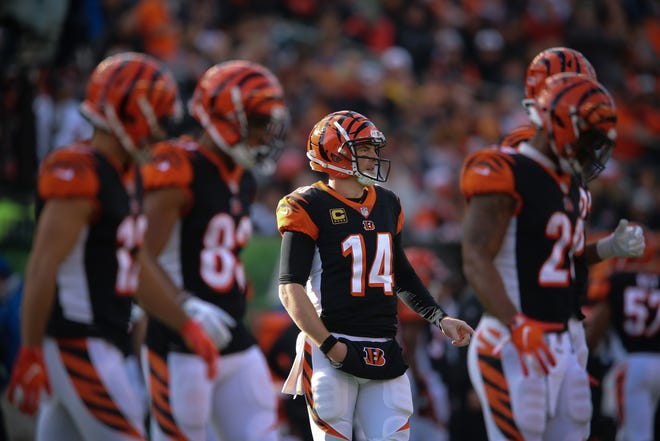 Bengals quarterback Andy Dalton, center, will be looked for weapons to emerge in the passing game without injured star A.J. Green.