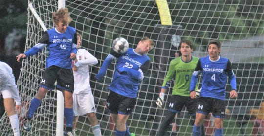 Highlands senior Keegan Brewer, 22, deflects a shot in front of the Bluebirds net during Highlands' 3-0 win over Daviess County in a KHSAA boys soccer state quarterfinal Oct. 27, 2018 at Paul Laurence Dunbar HS, Lexington KY.