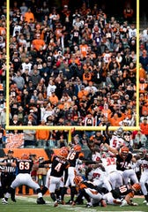Cincinnati Bengals kicker Randy Bullock (4) kicks a field goal with no time left on the clock putting Cincinnati Bengals up on Tampa Bay Buccaneers 37-34 during a Week 8 NFL game, Sunday, Oct. 28, 2018, at Paul Brown Stadium in Cincinnati.