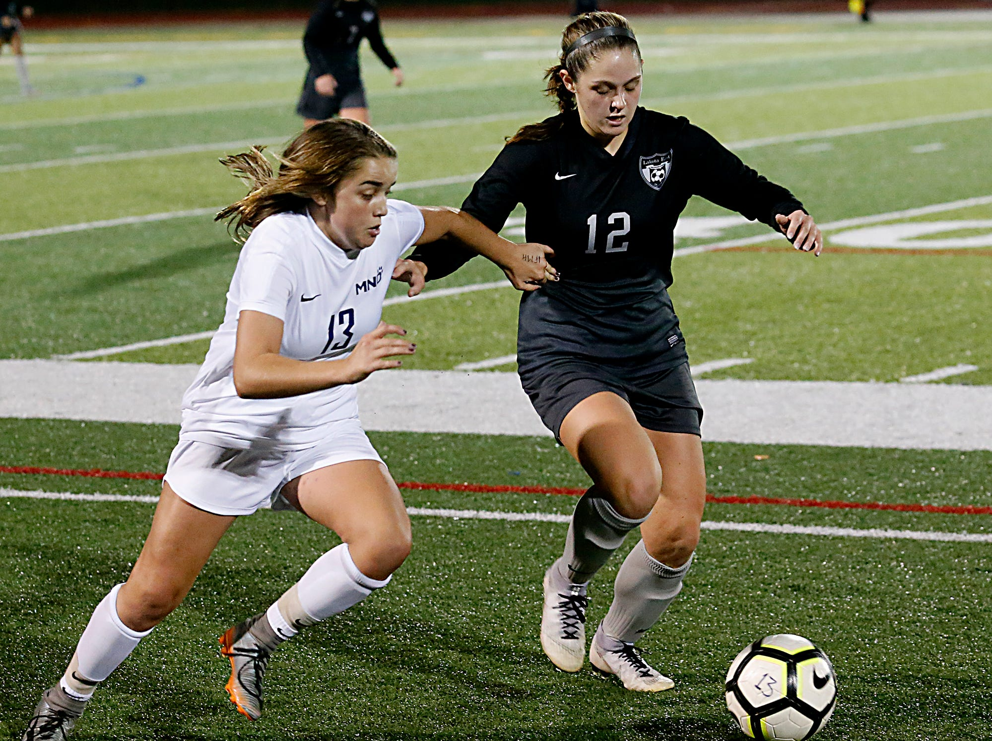 Mount Notre Dame midfielder Emma Frey and Lakota East defender Ashley Whitehead chase the ball during their Division I Southwest district final soccer game at Walnut Hills in Cincinnati Saturday, Oct. 27, 2018.