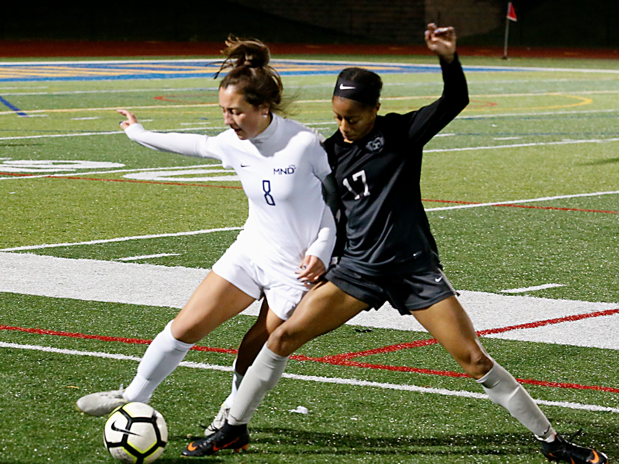 Mount Notre Dame forward Lauren Ritter and Lakota East defender Brooke Brown battle for the ball during their Division I Southwest district final soccer game at Walnut Hills in Cincinnati Saturday, Oct. 27, 2018.