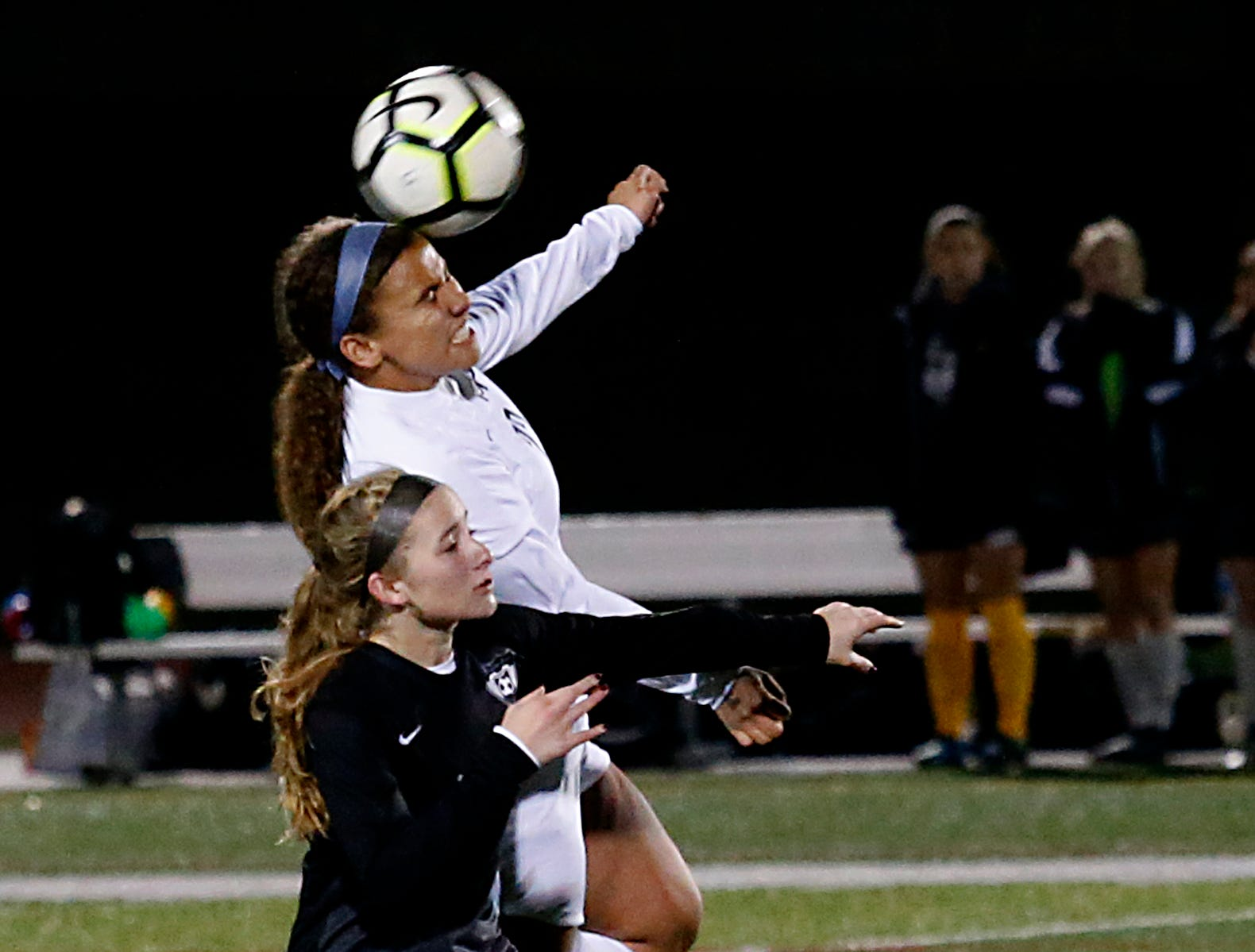 Mount Notre Dame defender Lexi Watson heads the ball away from Lakota East forward Sophie Amaya during their Division I Southwest district final soccer game at Walnut Hills in Cincinnati Saturday, Oct. 27, 2018.
