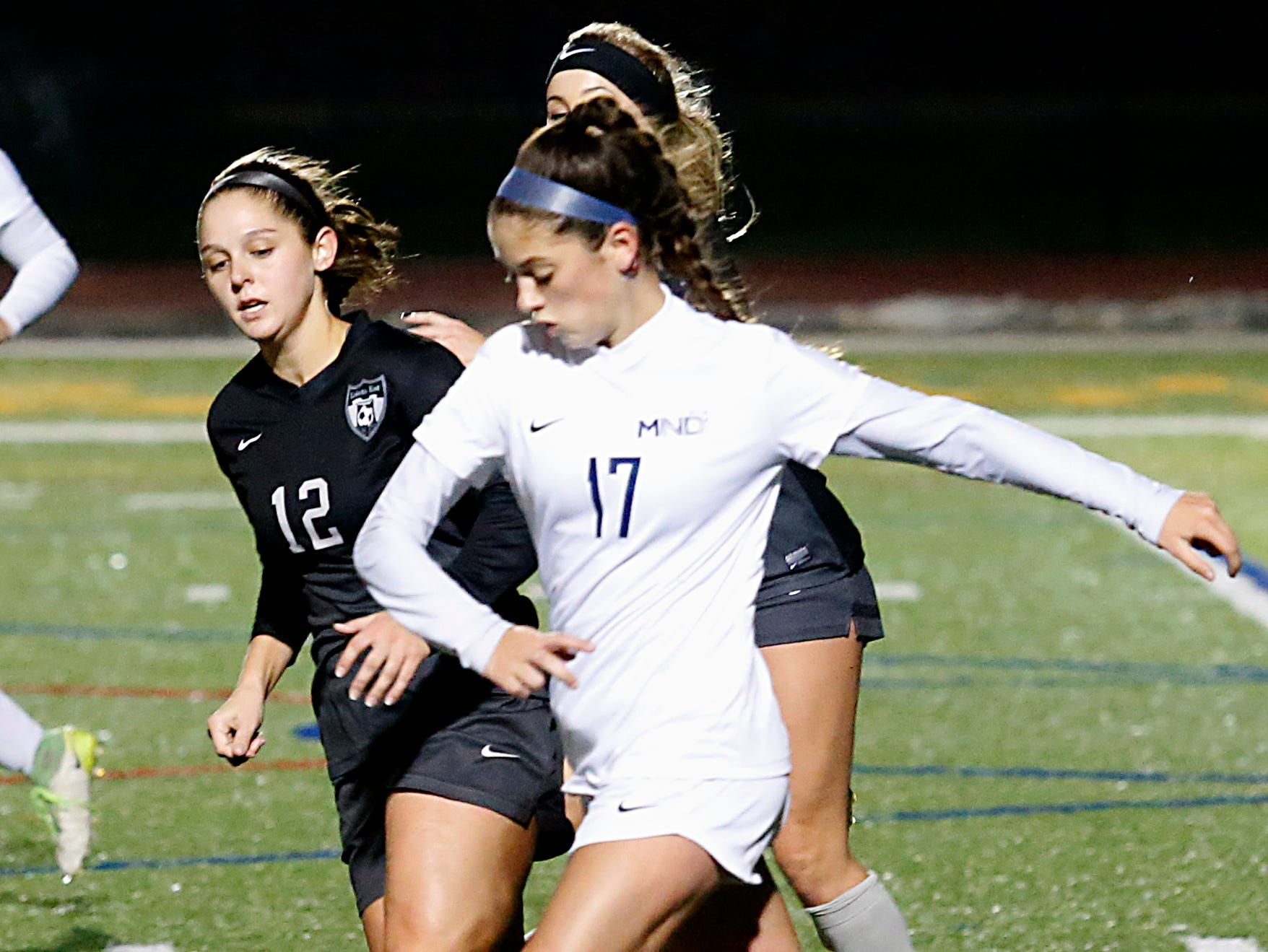 Mount Notre Dame defender Eden Marques keeps the ball away from Lakota East defender Ashley Whitehead during their Division I Southwest district final soccer game at Walnut Hills in Cincinnati Saturday, Oct. 27, 2018.