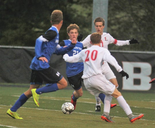 Highlands senior Carter Holmes and junior Porter Hedenberg go after the ball during Highlands' 3-0 win over Daviess County in a KHSAA boys soccer state quarterfinal Oct. 27, 2018 at Paul Laurence Dunbar HS, Lexington KY.