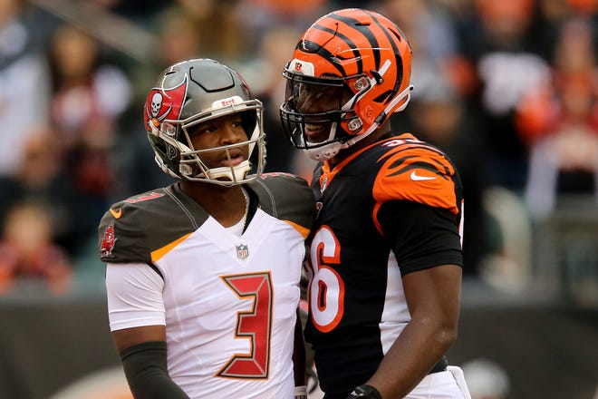 Cincinnati Bengals defensive end Carlos Dunlap (96) talks to Tampa Bay Buccaneers quarterback Jameis Winston (3) between plays in the first quarter during a NFL football game between the Tampa Bay Buccaneer and the Cincinnati Bengals, Sunday, Oct. 28, 2018, at Paul Brown Stadium in Cincinnati.