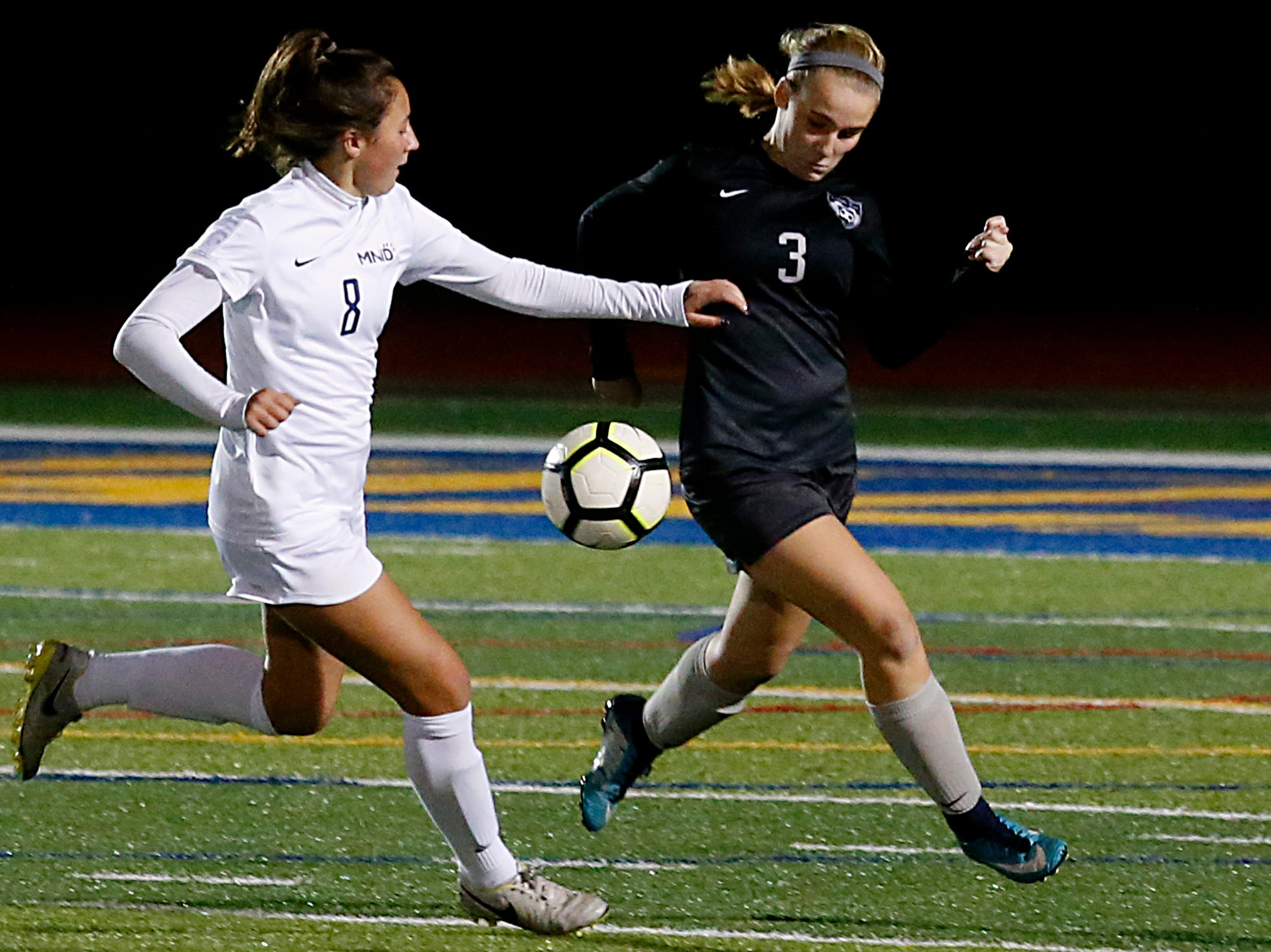 Mount Notre Dame midfielder moves the ball as Lakota East defender Mackenzie Bierman pursues during their Division I Southwest district final soccer game at Walnut Hills in Cincinnati Saturday, Oct. 27, 2018.