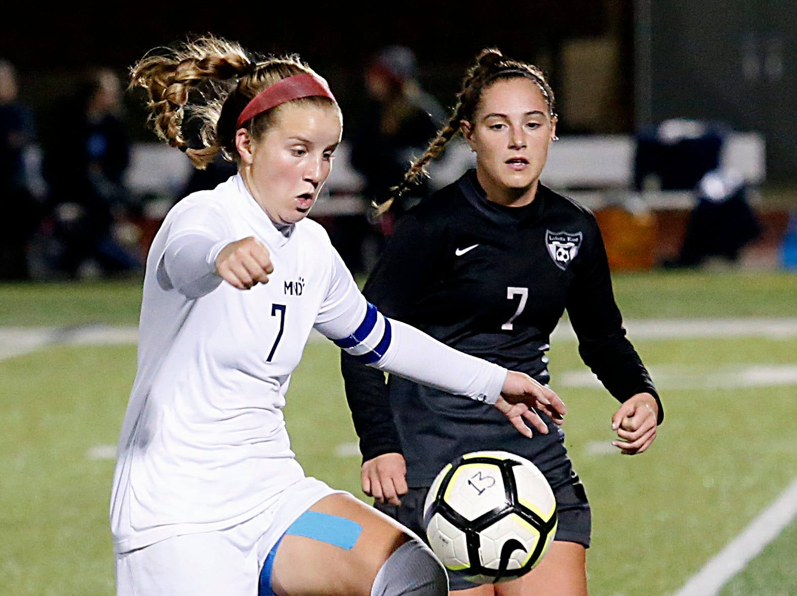 Mount Notre Dame midfielder Becky Dean controls the ball as Lakota East forward Kate Larbes gives chase during their Division I Southwest district final soccer game at Walnut Hills in Cincinnati Saturday, Oct. 27, 2018.
