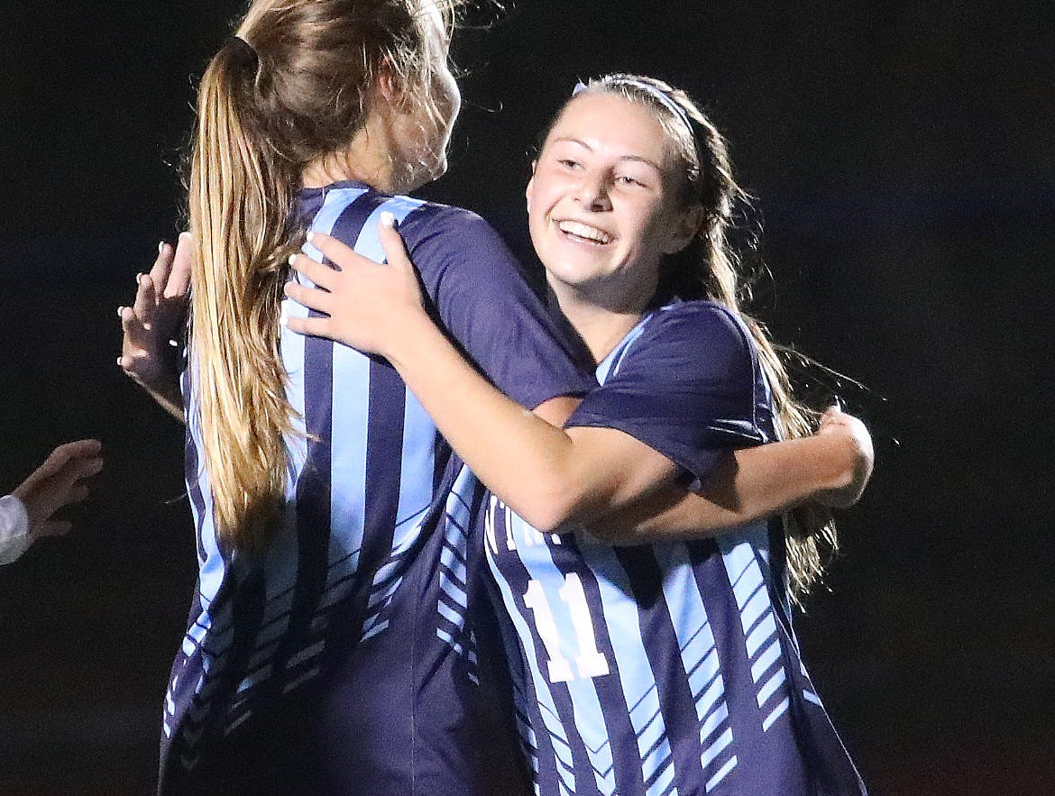 Cincinnati Country Day players Katie Ashwell and Jenna Setters celebrate after a goal  during their tournament game against Preble Shawnee  Saturday, Oct. 27,2018.