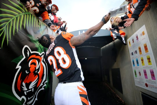 Cincinnati Bengals running back Joe Mixon (28) throws his gloves to fans after a NFL football game between the Tampa Bay Buccaneer and the Cincinnati Bengals, Sunday, Oct. 28, 2018, at Paul Brown Stadium in Cincinnati. Cincinnati Bengals won 37-34.