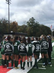 The East Brunswick girls soccer coaches talk to the team after the Bears won GMCT